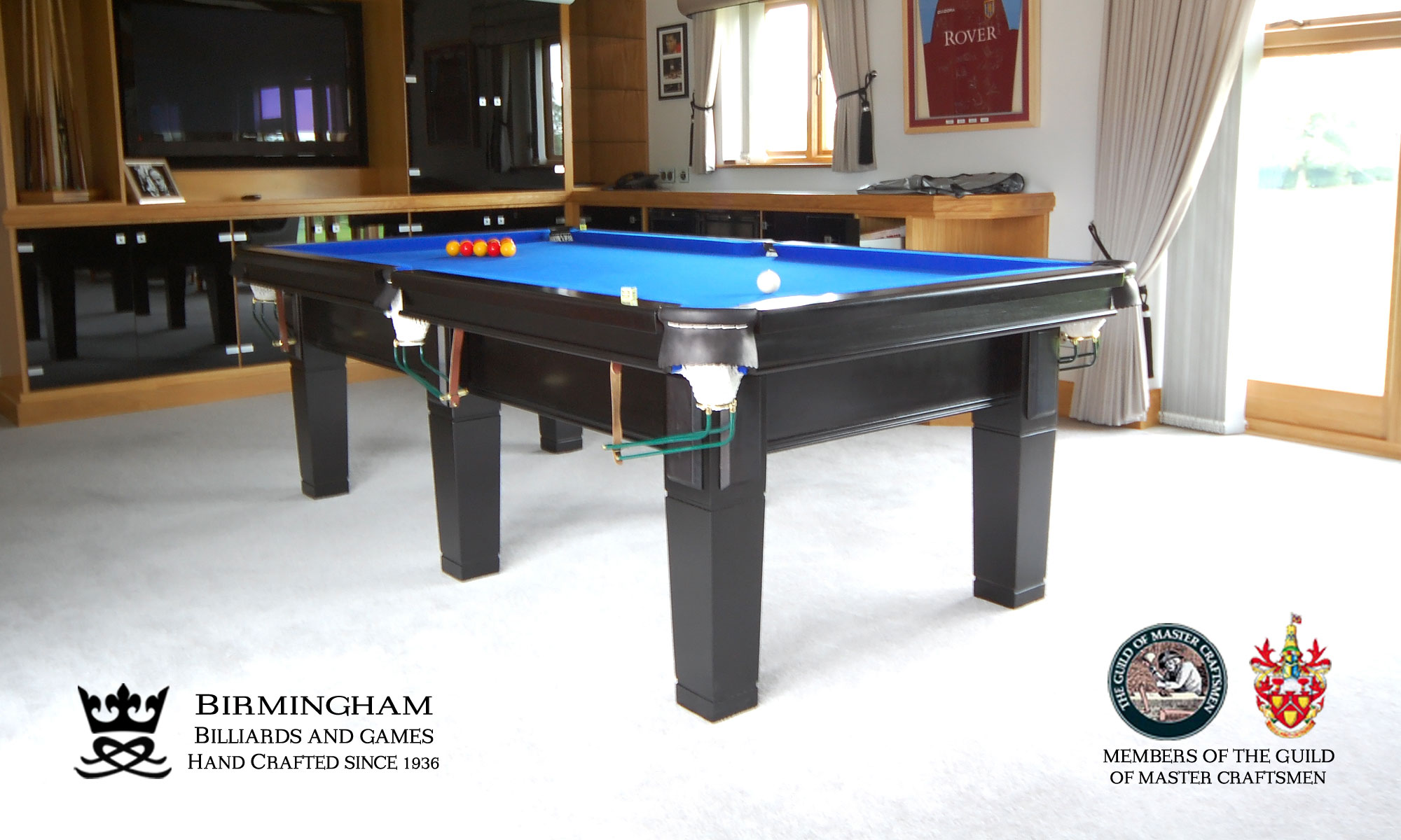 The Contemporary handmade pool table, black ebony finish, royal blue baize, side view