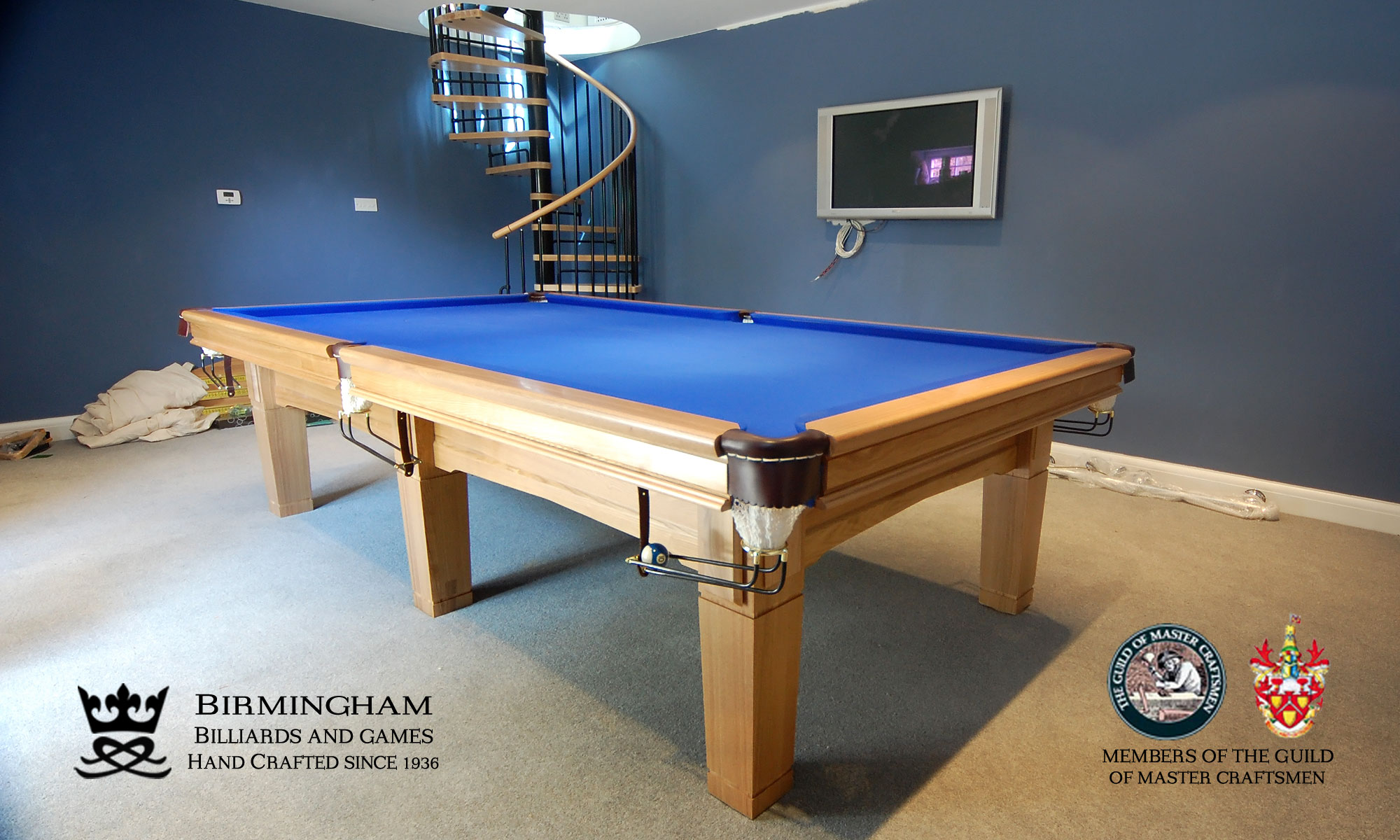 The Contemporary handmade pool table, light oak finish, royal blue baize, end view