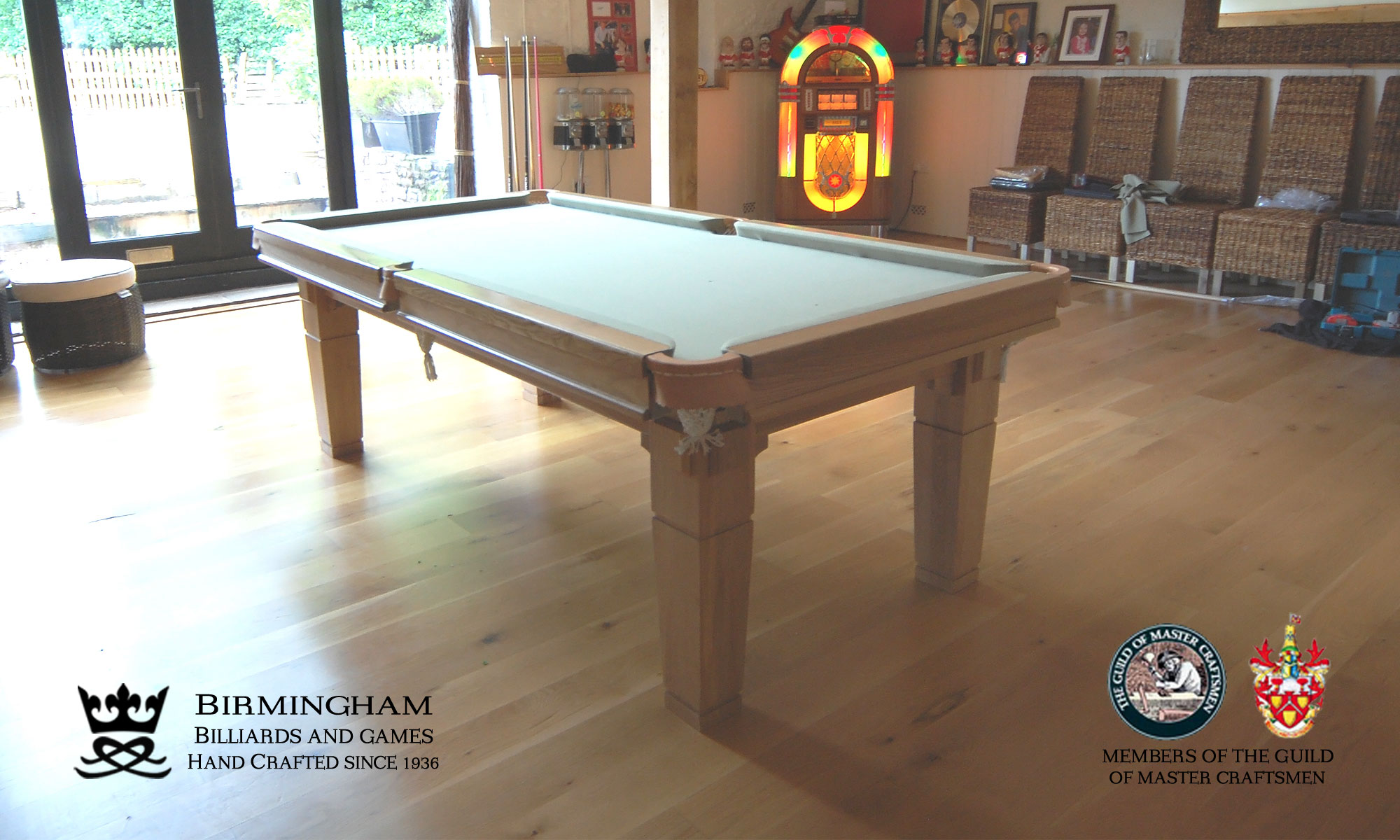 The Contemporary handmade pool table, light oak finish, sage baize, end view