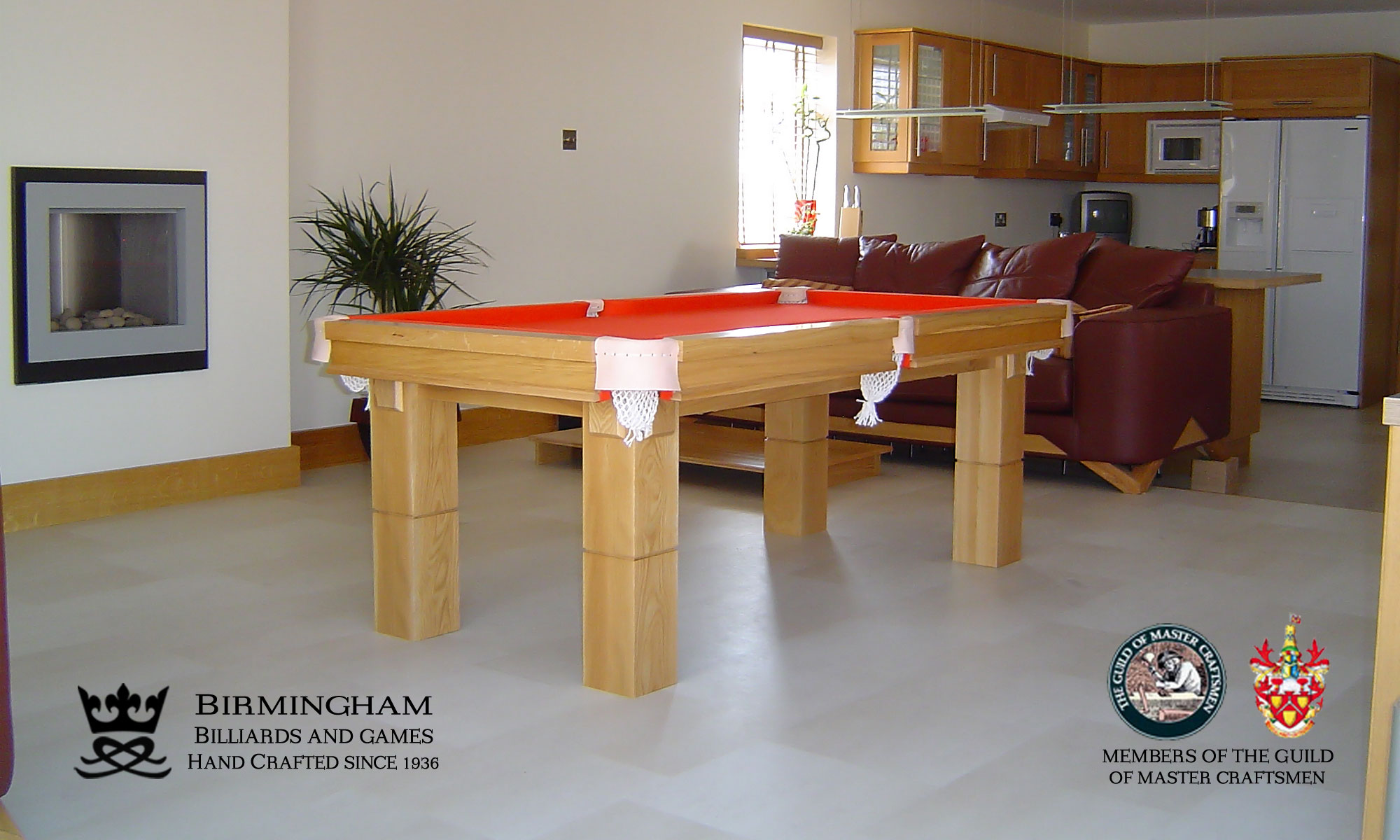 The Retro-luxury handmade pool table in light oak and olive red baize