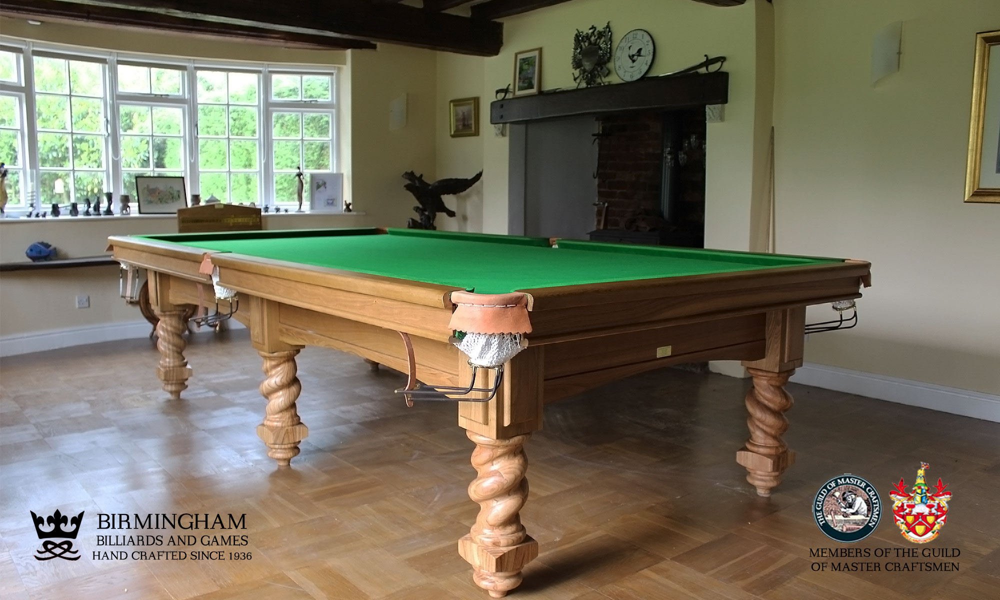 The Barley Twist bespoke snooker table in olive green baize