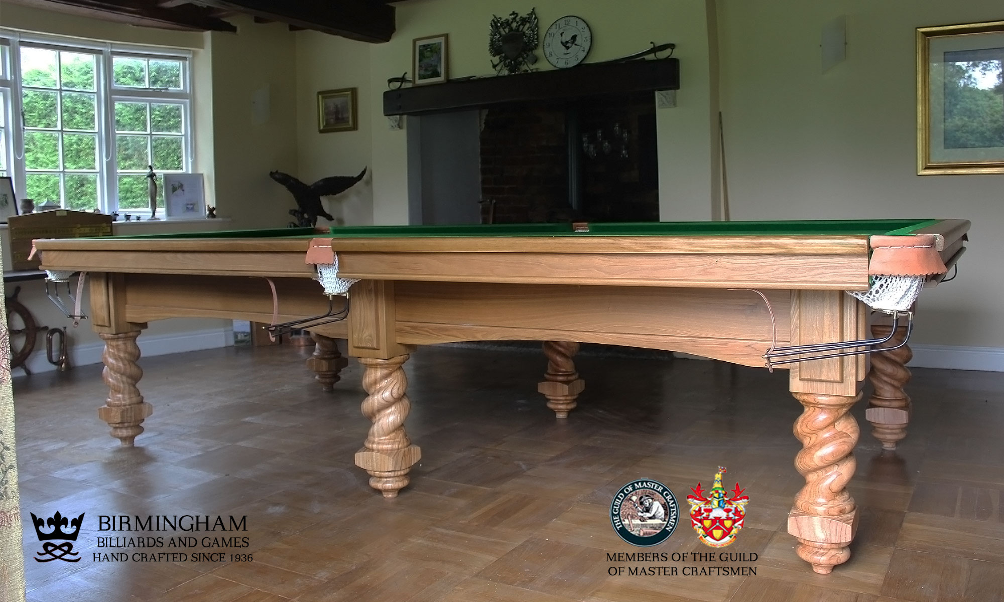 The Barley Twist bespoke snooker table in olive green baize, side view